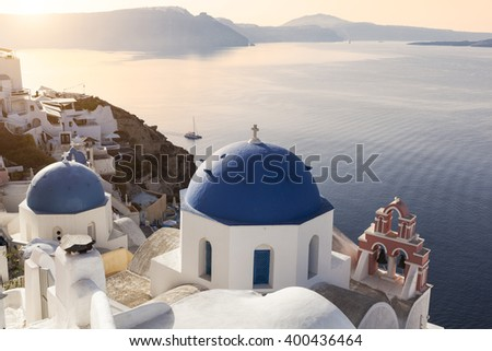 Sun on the blue domes in Oia