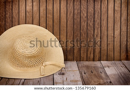Sun or Straw hat on antique wooden background - stock photo