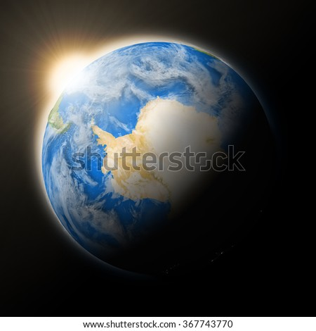 Sun over Antarctica on blue planet Earth isolated on black background. Highly detailed planet surface. Elements of this image furnished by NASA.