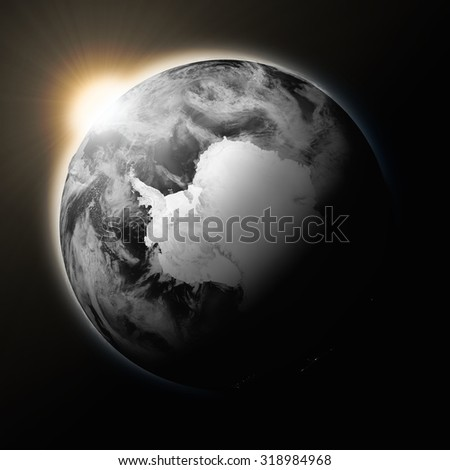 Sun over Antarctica on dark planet Earth isolated on black background. Highly detailed planet surface. Elements of this image furnished by NASA. - stock photo