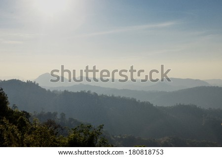 sun over beauty misty mountains
