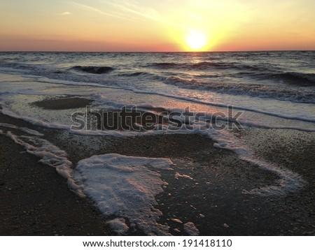 Sun over Delaware Bay - stock photo
