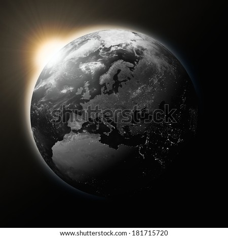 Sun over Europe on dark planet Earth isolated on black background. Highly detailed planet surface. Elements of this image furnished by NASA.