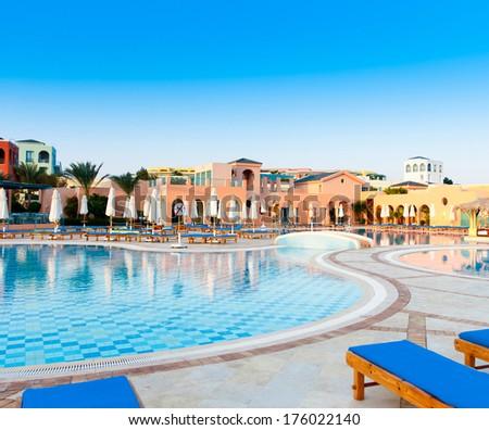 Sun over Hotel Pool  - stock photo
