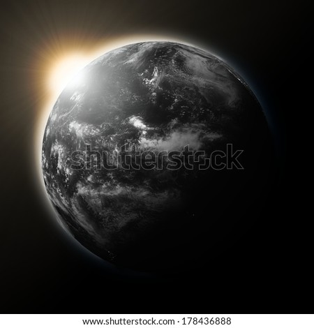 Sun over Pacific Ocean on dark planet Earth isolated on black background. Elements of this image furnished by NASA. - stock photo