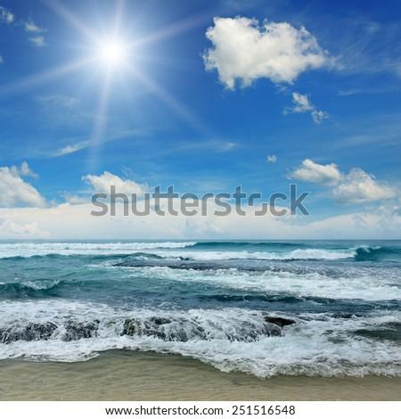sun over sea and blue sky - stock photo