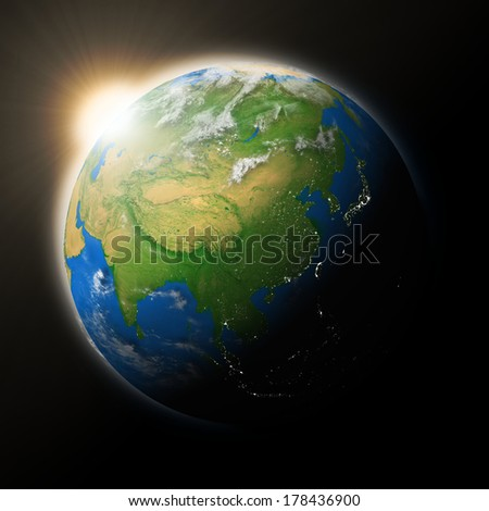 Sun over Southeast Asia on blue planet Earth isolated on black background. Highly detailed planet surface. Elements of this image furnished by NASA.