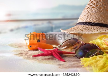 Sun protection articles with starfish on sand in glass table in terrace overlooking beach and sun shine. Horizontal composition. Front view - stock photo
