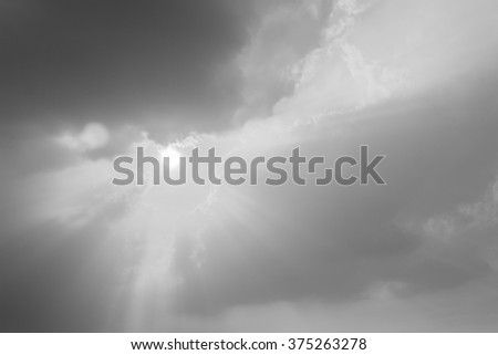 Sun ray of sun light like bird from a cloudscape - stock photo