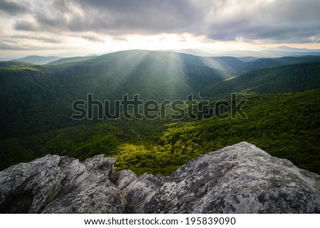 Sun rays beaming down in to the Linville Gorge from Hawksbill Mountain in the Blue Ridge Mountains of North Carolina
