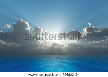 sun rays in clouds over blue sea - stock photo