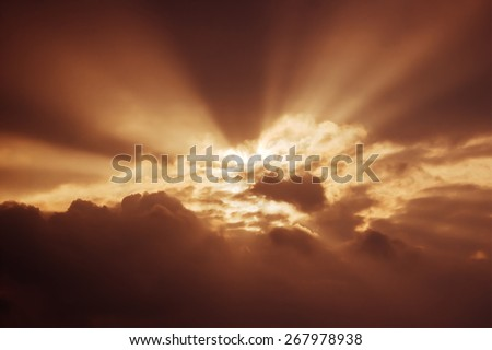 sun rays in the sky at sunset - stock photo