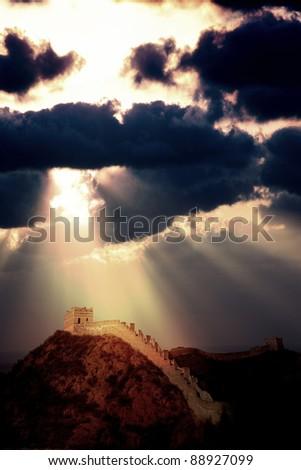 Sun rays shine on the Great Wall, China - stock photo