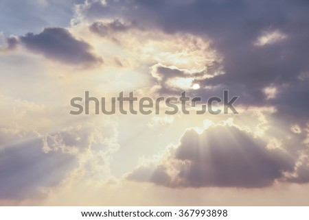 Sun rays ,sky and clouds.