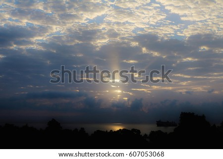 sunrise with clouds over water sun peeking through clouds stock images royalty free images