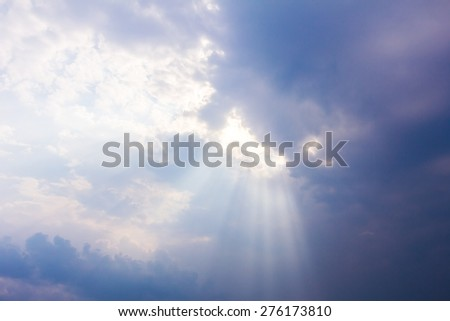 sun rays through cloudy sky, hope symbol - stock photo