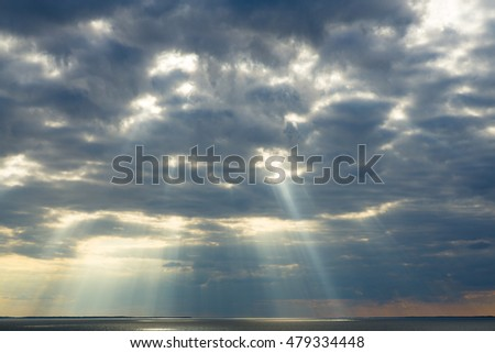 Sun rays through the clouds.