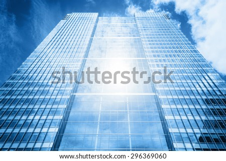 Sun reflecting in a usual modern business skyscraper, high-rise building, architecture raising to the sky Concepts of financial, economics, future etc. - stock photo
