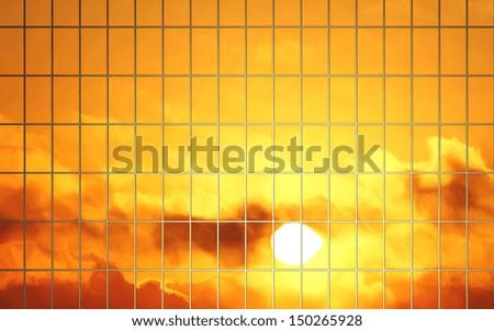 sun reflection in glass wall of skyscraper - stock photo