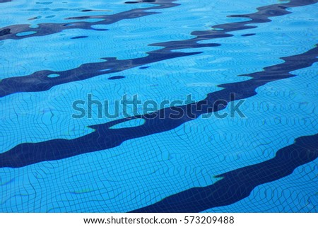 Dark Blue Pool Water texture blue tile under water in the swimming stock images