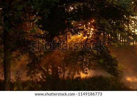 sun rise above river