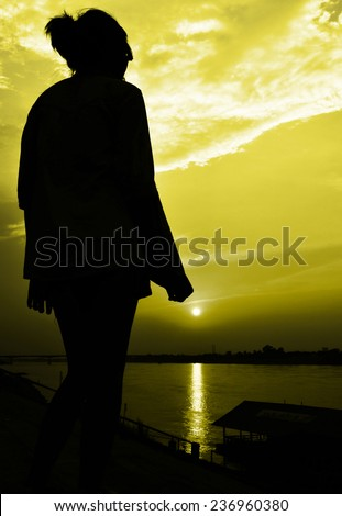 sun rise with girl siluate scene abstract,yellow color tone - stock photo