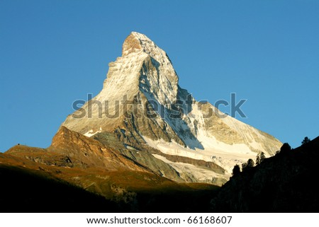 Sun rises over Matterhorn, one of the world's most famous mountains, located in Switzerland.
