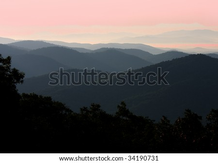 Sun rises over the blue ridge mountains of North Carolina Apalachia