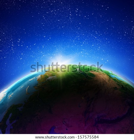 Sun rising above Earth planet. Conceptual photo. Elements of this image are furnished by NASA
