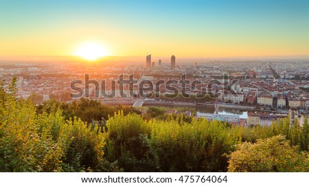 Sun rising above Lyon on a summers day. Seen from landmark Fourviere Baslilica.
