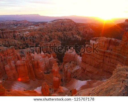 Sun rising in Bryce Canyon National Park, view from Sunset point, Utah, USA - stock photo