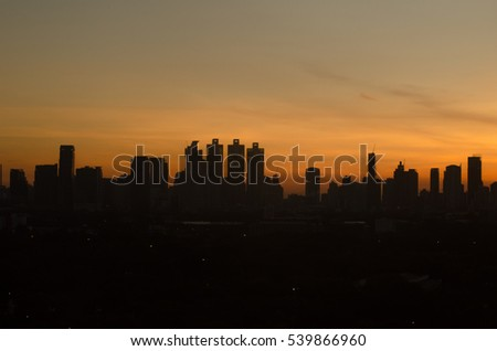 Sun rising over modern Bangkok city Thailand