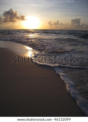 Sun rising over pink sand beach in Bermuda - stock photo