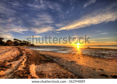 Sun rising over Rhyll beach, Phillip Island, Australia