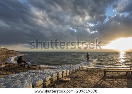 sun set in dead sea - stock photo