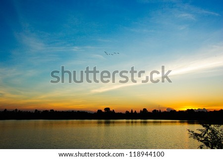 Sun set in the river - stock photo