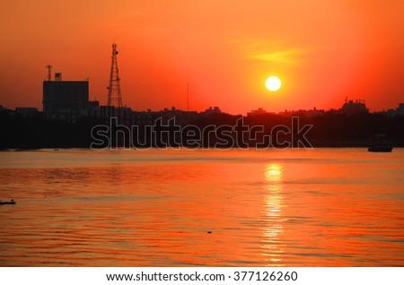 Sun set over Hyderabad city in India - stock photo