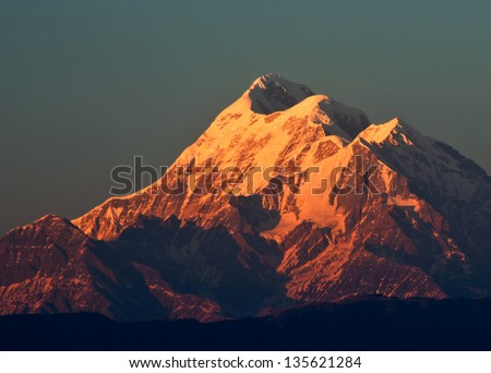 "sun set scene over Mountain "" Trishul"" In Indian Himalaya - stock photo"