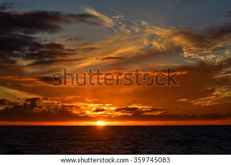 Sun setting above the Pacific Ocean, Kauai, Hawaii