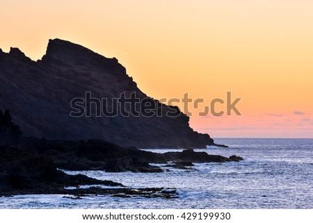 Sun Setting on the Atlantic Ocean in Tenerife Canary Island Spain - stock photo
