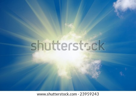 Sun shine from behind cloud on blue sky