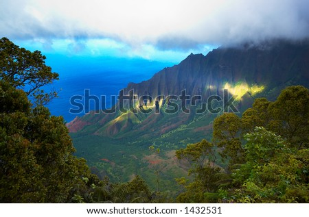 Sun shine over Kalalau on Kauai Hawaii. More with keyword Series001D. - stock photo