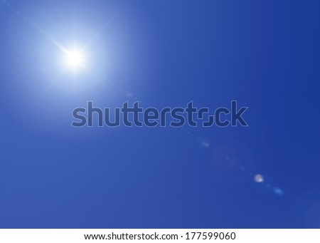 Sun shining bright in a blue sky on a clear day, with lens flare. - stock photo