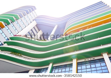 Sun shining colors of the Siriraj Hospital building. Public places. - stock photo