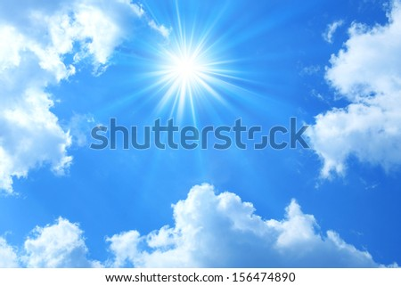 Sun shining in blue sky - stock photo