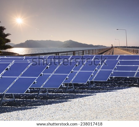 sun shining over sky and lake of generator electric dam with solar cell panel use for alternative natural energy of natural,ecology power source - stock photo