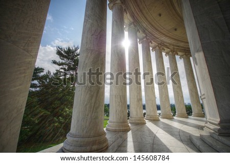 Sun shining through columns at the Jefferson Memorial in Washington DC - stock photo