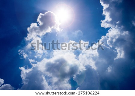 Sun shining through the clouds and a beautiful view,the sun causing lens flare - stock photo