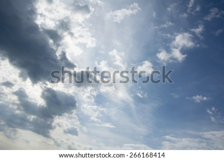 sun shining through the clouds in the sky. - stock photo