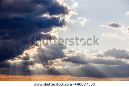 sun shining through the stormy clouds, god rays, sky background